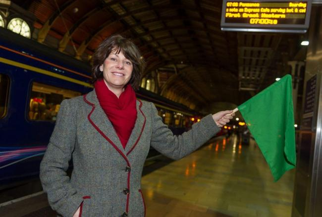 Rail Minister Claire Perry waving off the first new 0706 retimed service.