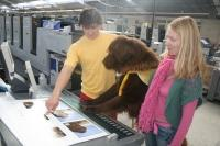 Steve Jmo, Bilbo and Janeta Hevizi watching the book being printed