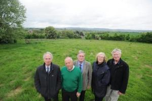 Opponents at the site before planning permission was granted.