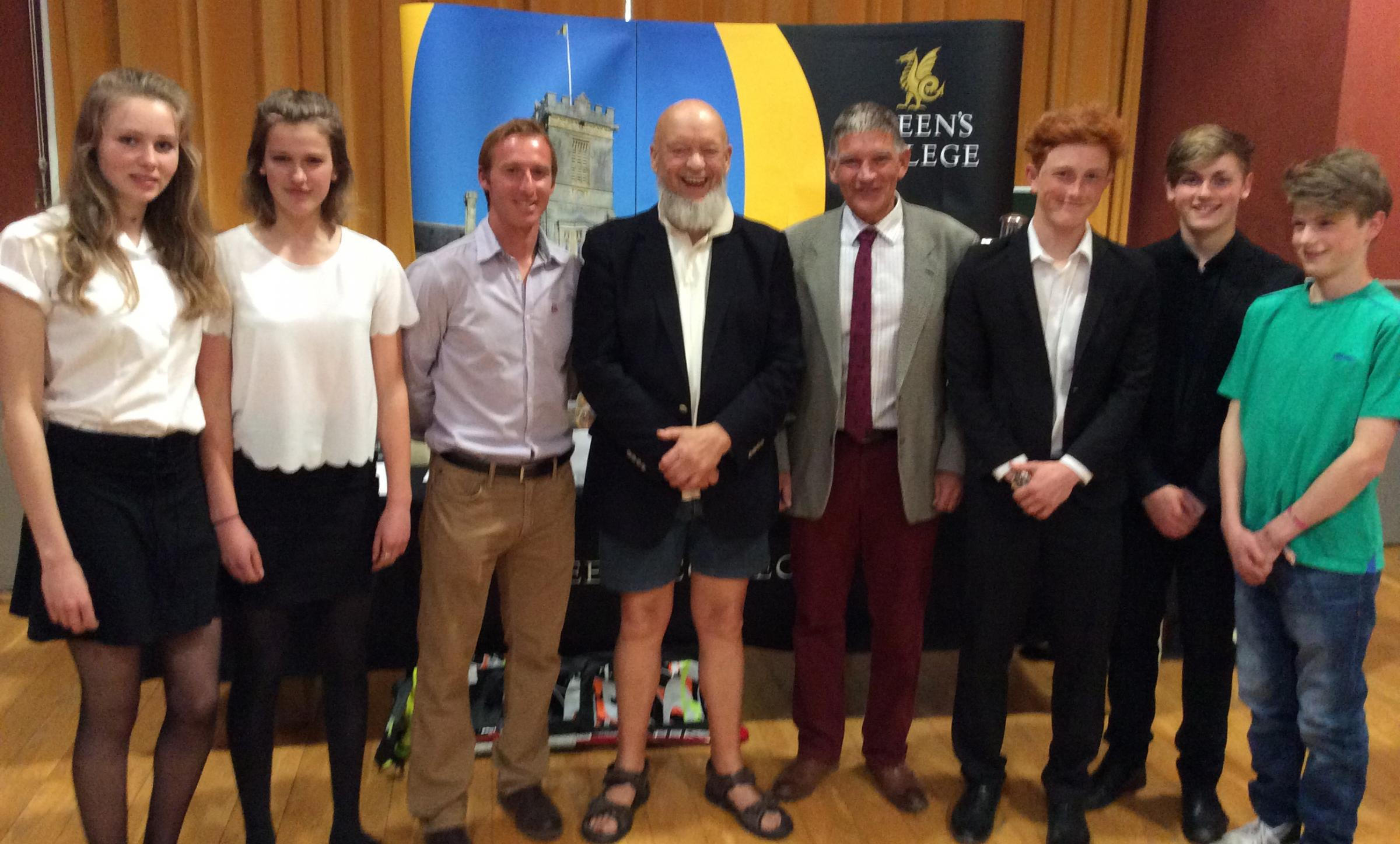 TALK: Michael Eavis at the talk and, inset, with director of hockey Ian Haley, third from left, Chris Alcock, headmaster, fourth from left and students, from left, Jess Brown, Pippa Hoyle, Tom Stevenson, Michael Nicholson and Rory Nicholson