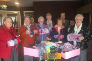 THANK YOU: The Woolavington Women's Institute with Kim Leech, manager of Casa di Lusso on Bower Lane in Bridgwater and the Twiddlemuffs