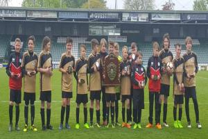 HISTORIC: Avishayes Combe Vultures celebrate their first ever High Holborne Shield title.
