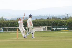 CHARGE: Huntspill & District Under-15s bowler James Garner in action on Sunday. Pic: Ash Magill
