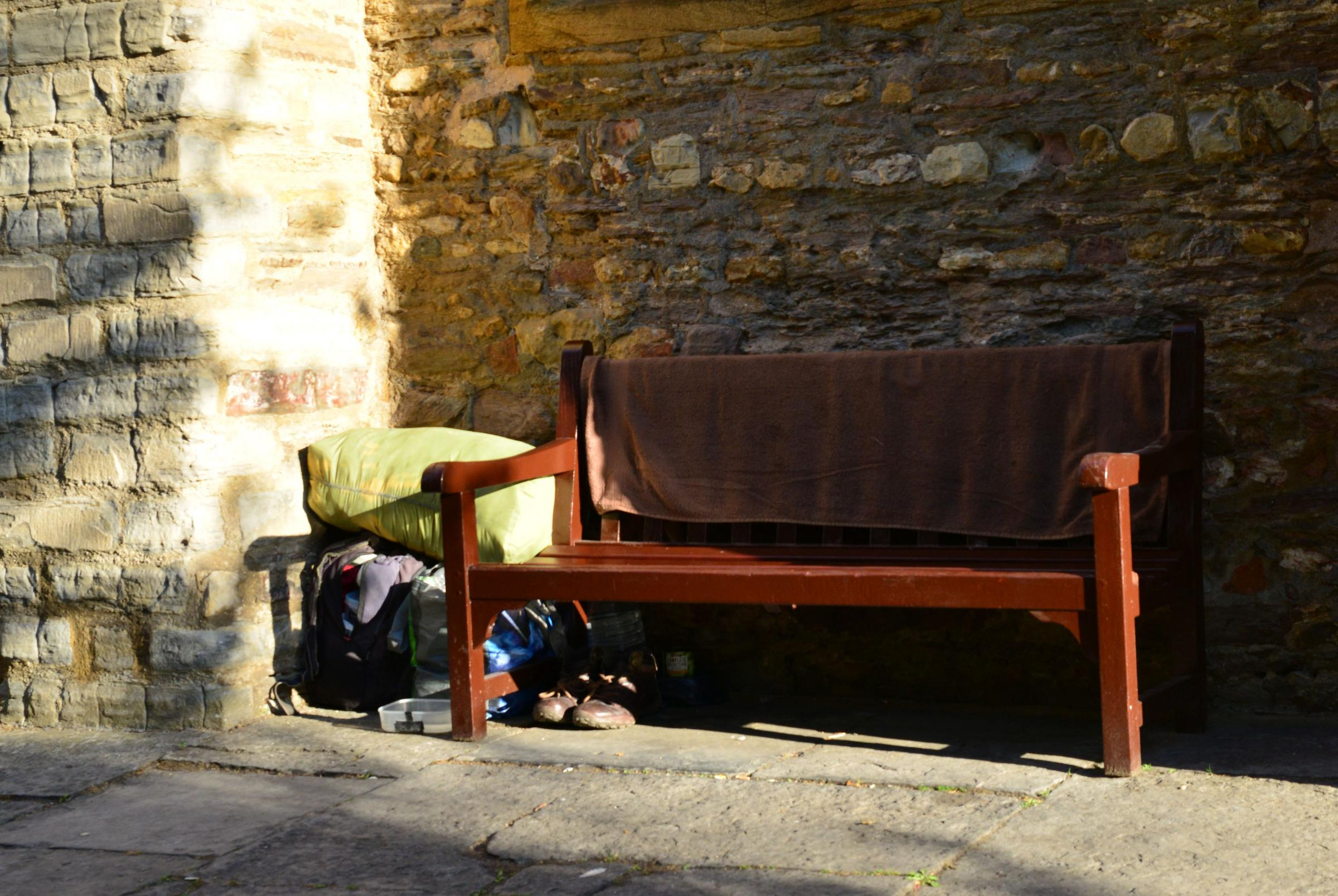 BELONGINGS: One rough sleeper's items tidied away behind a bench in Taunton