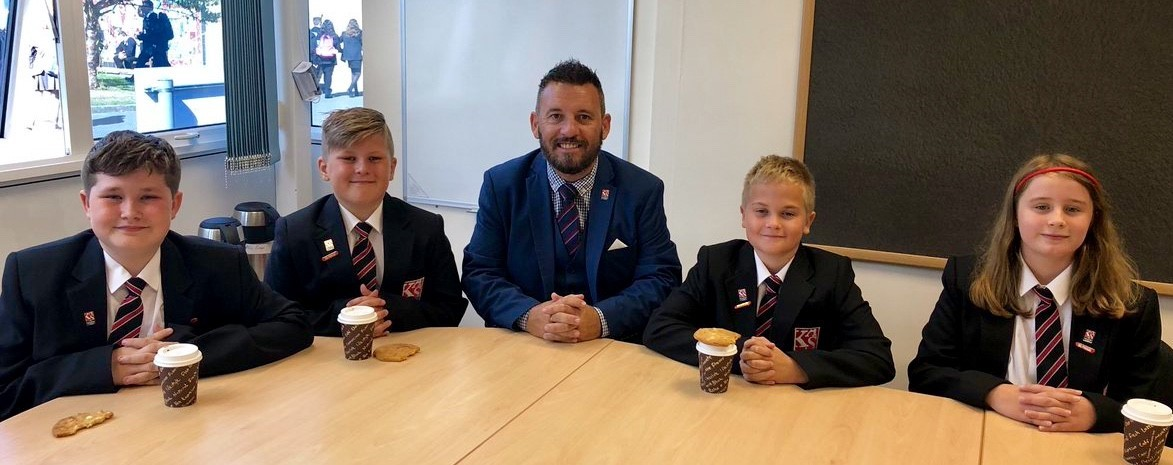 SUCCESS: Nathan Jenkins, headteacher of The King Alfred School with the students of the week