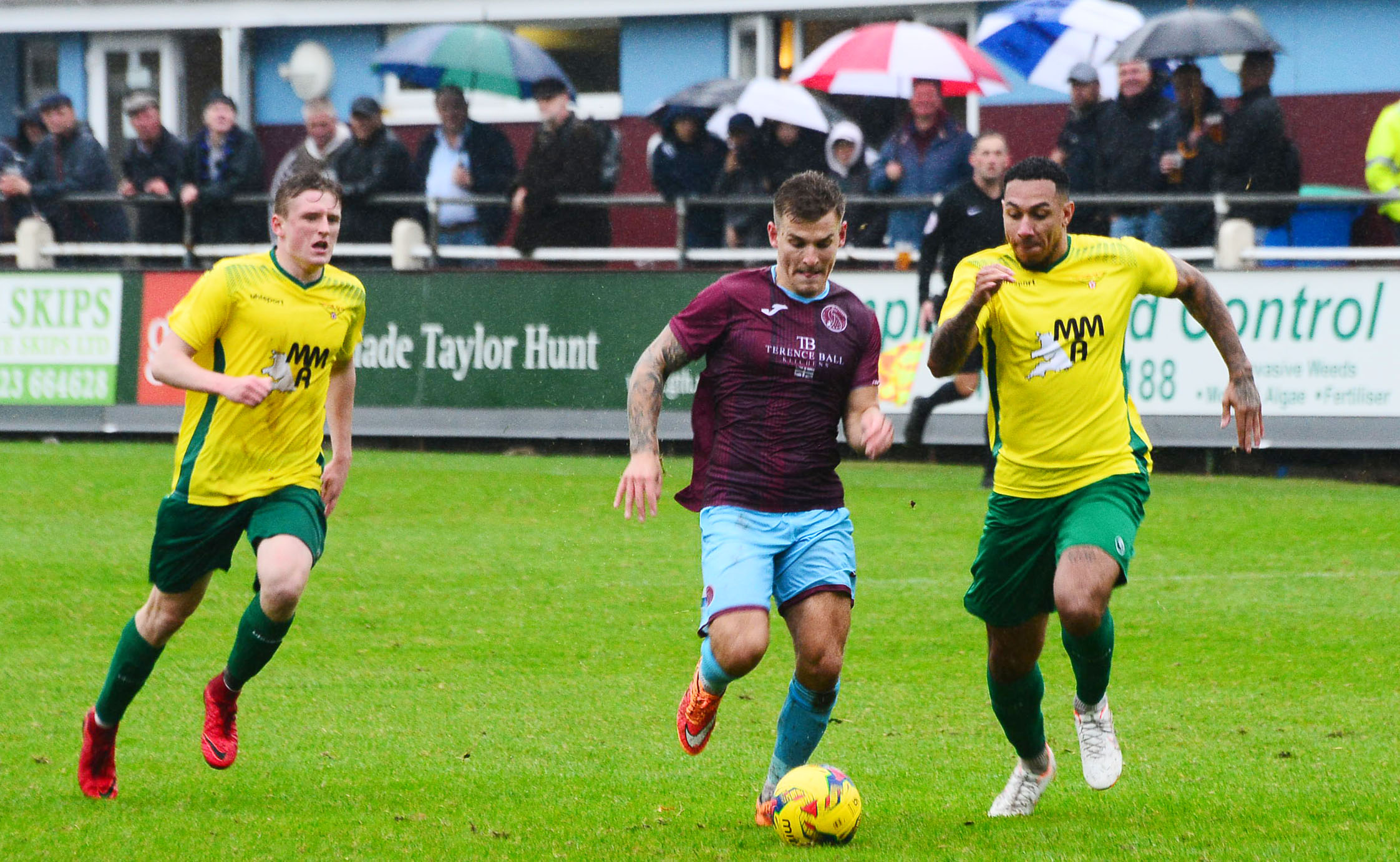 AT THE DOUBLE: Andrew Neal (pictured centre) scored twice for Taunton Town at Wincanton.