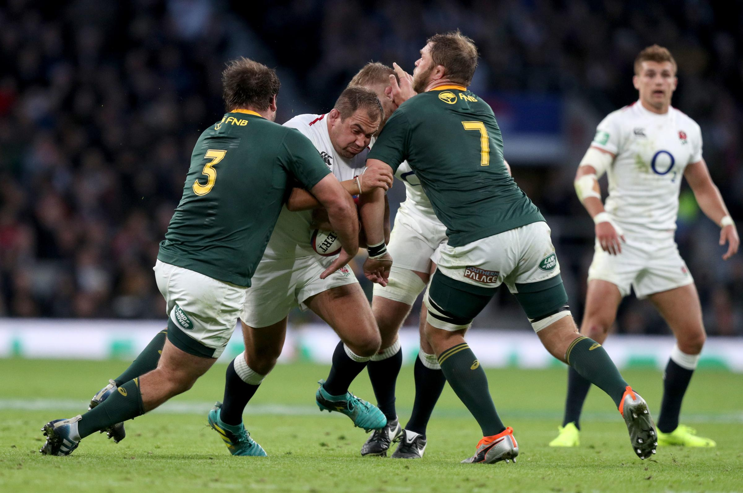 England's Ben Moon (2nd left) is tackled by South Africa's Frans Malherbe (left) and Duane Vermeulen during the Autumn International match at Twickenham Stadium, London. PRESS ASSOCIATION Photo. Picture date: Saturday November 3, 201
