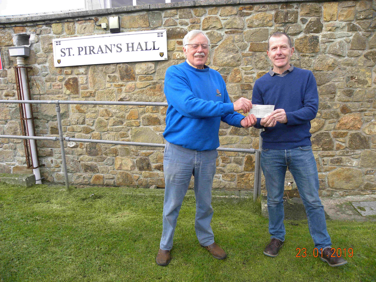 Photograph shows Jim Blain of Mount's Bay Rotary passing the cheque to Andy Moore, chairman of St Piran's Hall