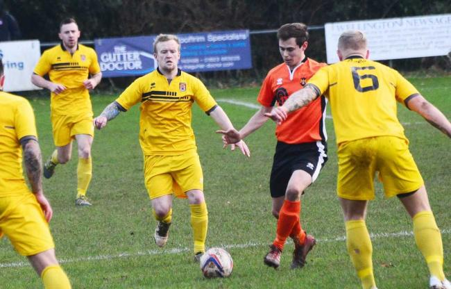 OPENER: Glen Wright (pictured in orange kit) scored for Wellington away to Roman Glass St George.