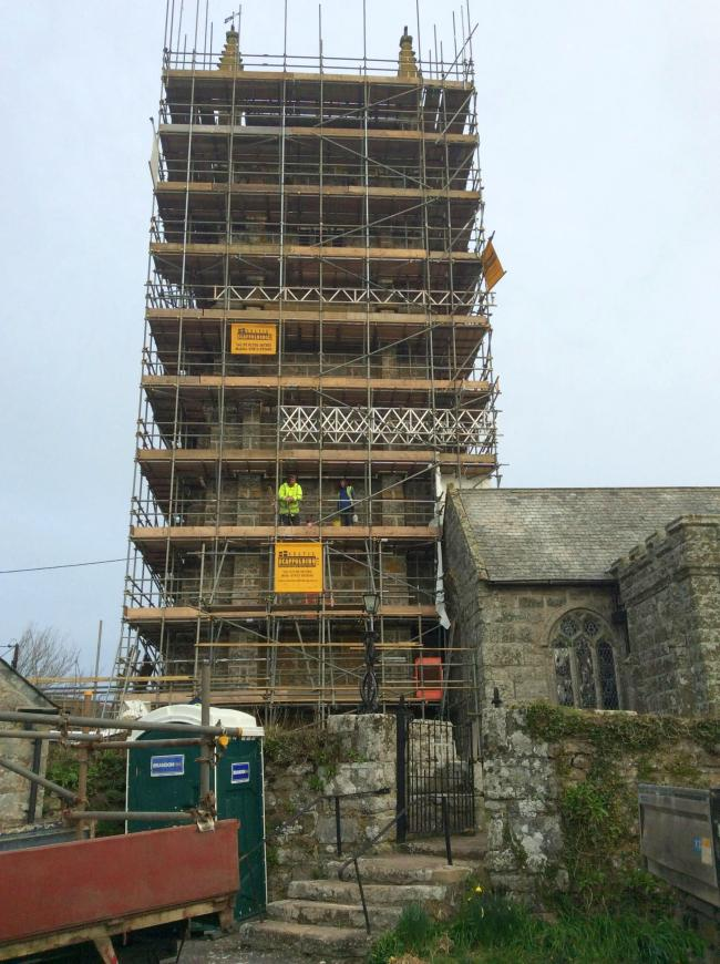 Village landmark re-emerges from six months of scaffolding