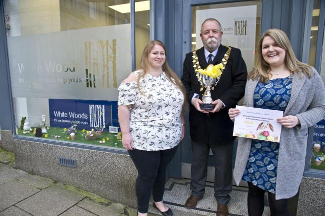 White Woods International owners Amy Woods and Georgina White are presented with their winner's certificate by mayor John Martin