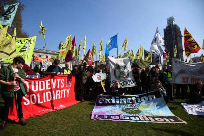 Demonstrators during a Extinction Rebellion protest in Parliament Square, London