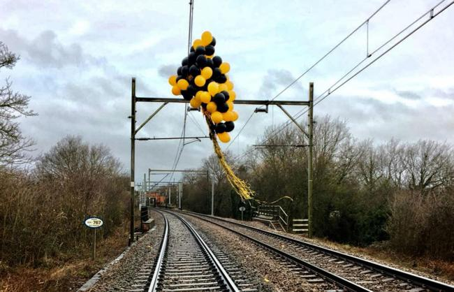 DELAYS :Helium balloons tangled around high-voltage overhead wires near Southend. Picture - PA