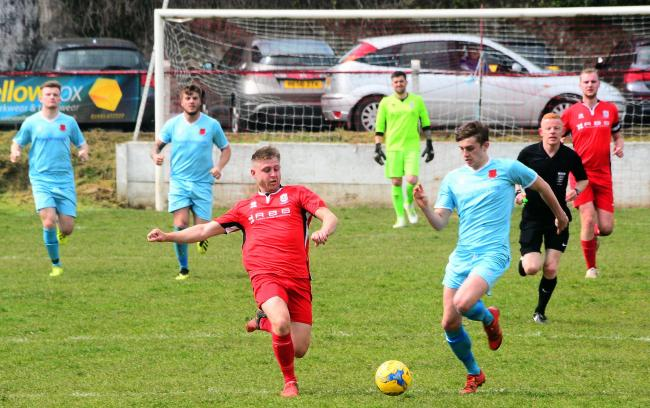 DOUBLE: Ryan Brereton (blue kit) scored twice for Bishops Lydeard against Bishop Sutton. Pic: Steve Richardson