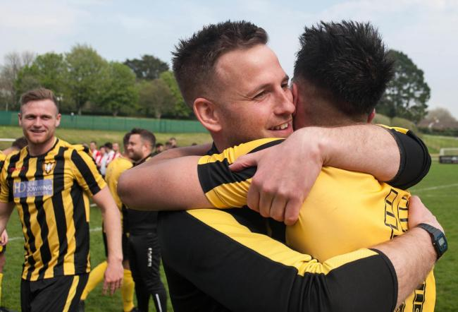 Falmouth Town manager Andrew Westgarth hugs midfielder Tim Nixon after Town won the Cornwall Senior Cup Final on Easter Monday. Picture by Colin Higgs