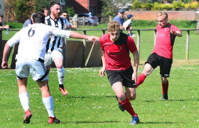 ON TARGET: Curtis Bradshaw (pictured in red kit, front) scored Burnham United's goal at Timsbury Athletic on Saturday