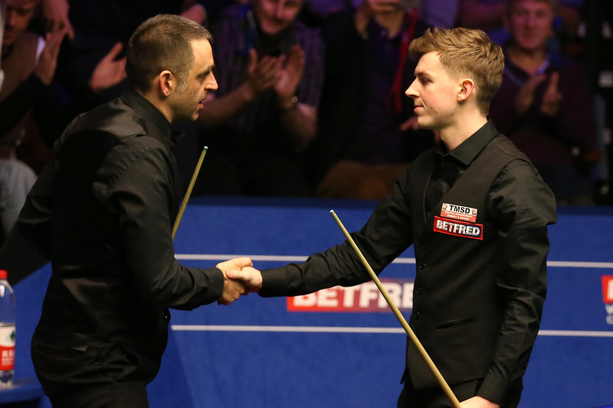 James Cahill, right, is congratulated by Ronnie O'Sullivan