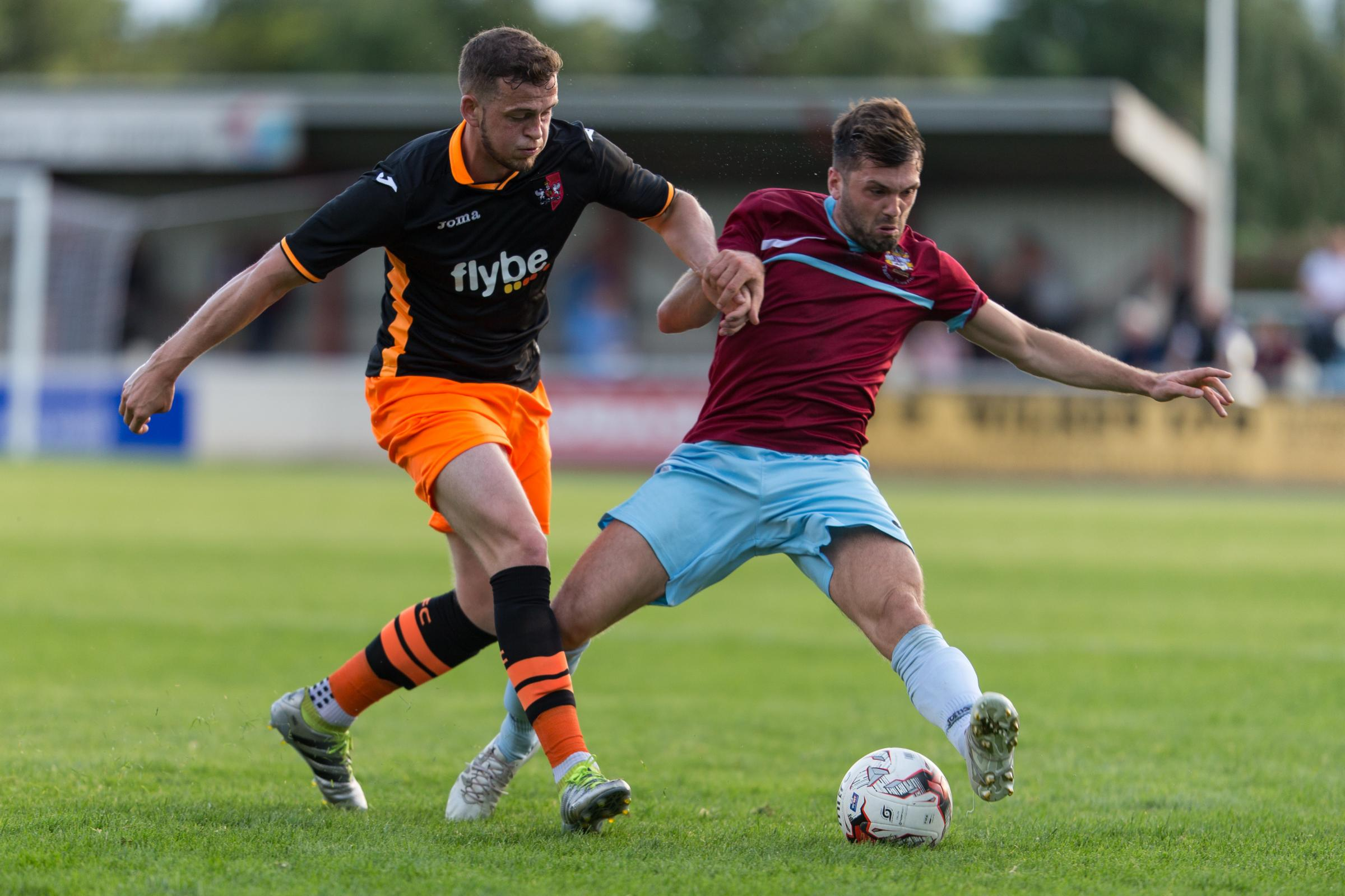 FAMILIAR OPPONENTS: Action from a pre-season friendly between Taunton Town and Exeter City