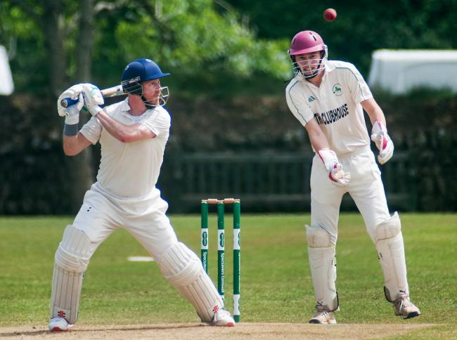 Helston batsman Justin Matthews watched by Rosudgeon & Kenneggy wicket keeper Max Walden. Picture by Colin Higgs