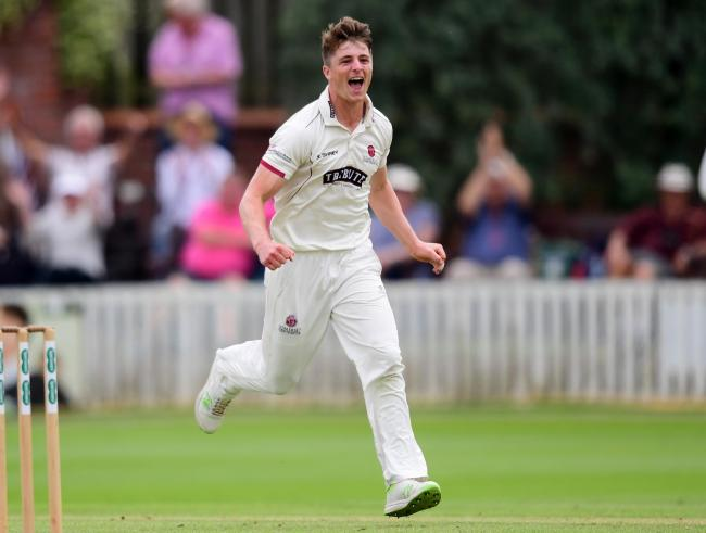 Tom Abell, captain of Somerset  celebrates the wicket of Tom Moores.