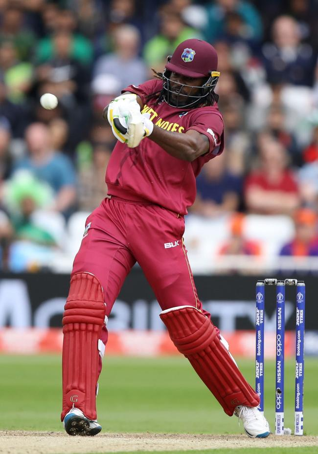MIND THE WINDOWS: Chris Gayle in action for West Indies